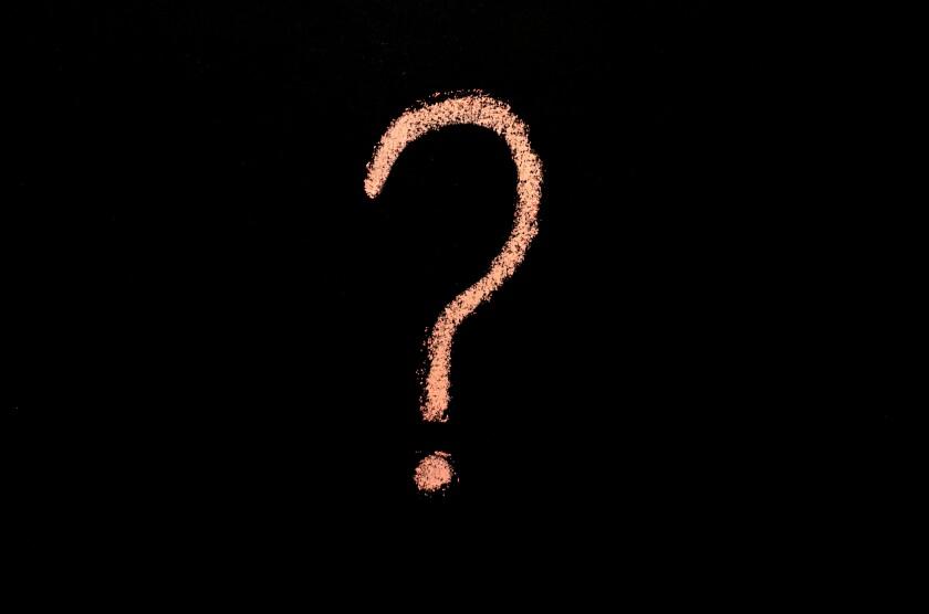 pink question mark on blackboard