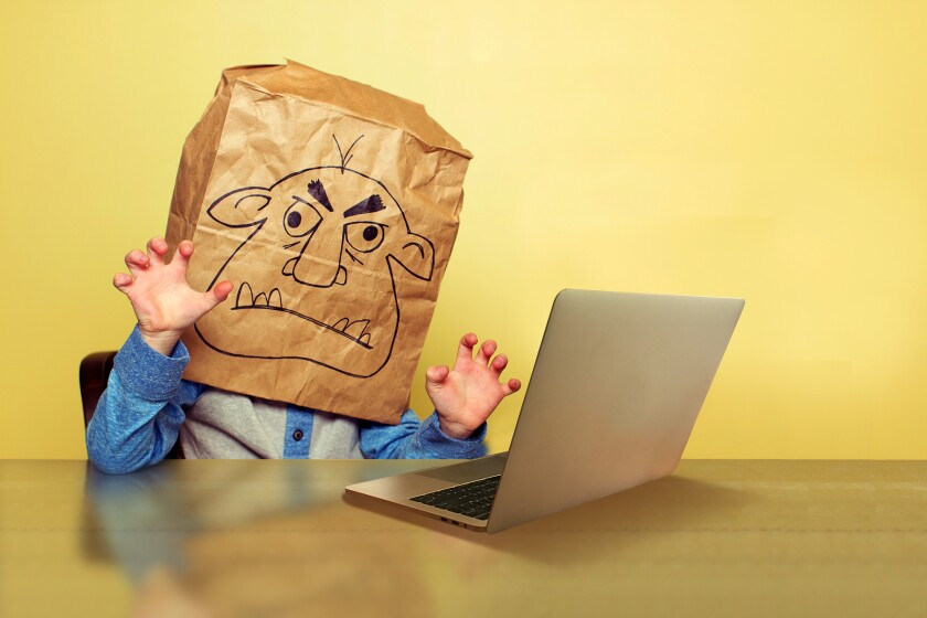 Bag covered head and laptop