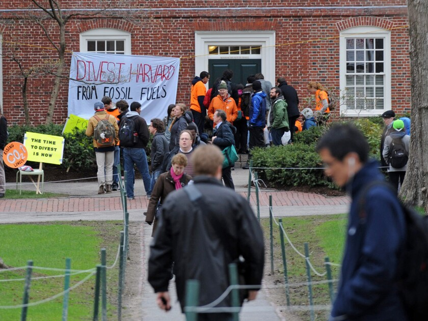 (Boston, MA, 04/30/14) Protestors block the main entrance to Harvard University President Drew Faust?s office, calling for an open meeting with Harvard?s governing body about fossil fuel divestment on Wednesday, April 30, 2014. Staff photo by Christo